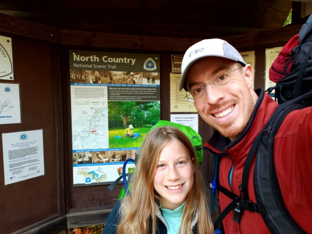Manistee River Trail sign picture with dad and daughter
